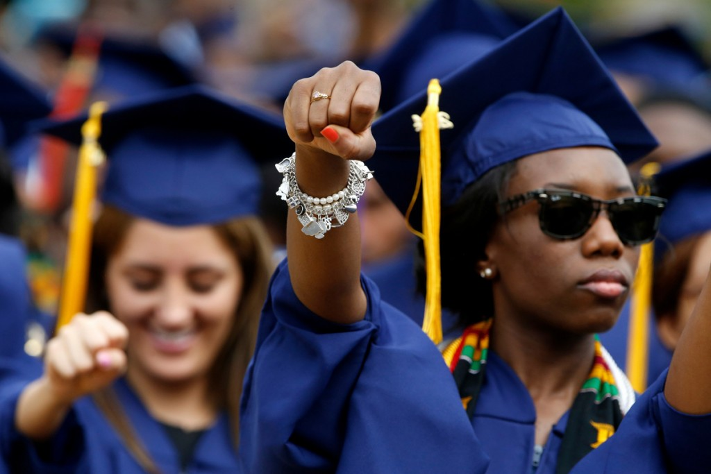 Graduates stand for anthem Lift Every Voice and Sing during 2014 commencement ceremonies at Howard University in Washington